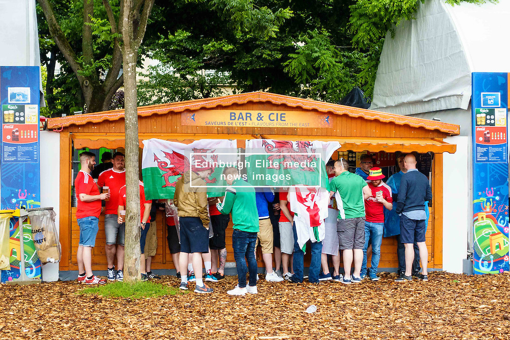 Wales fans shelter from the rain in the Paris Fanzone. Images from the UEFA EURO 2016, 14 June 2016. (c) Paul Roberts | Edinburgh Elite media. All Rights Reserved