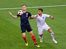 MOSCOW, RUSSIA - Wednesday, July 11, 2018: England's Kyle Walker tackles Croatia's Ivan Rakitić during the FIFA World Cup Russia 2018 Semi-Final match between Croatia and England at the Luzhniki Stadium. (Pic by David Rawcliffe/Propaganda)