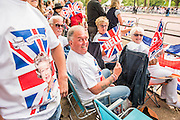 Scottich fans from Bellshill near Glasgow, on their 5 yearly visit - Queens 90th birthday was celebrated by the traditional Trooping the Colour as well as a flotilla on the river Thames.