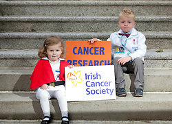 Repro Free: 17/09/2012.Charlotte Stafford (2) from Foxrock is pictured with Fionn O'Hagan from Dun Laoghaire as the Irish Cancer Society today announced that the Society has taken a major step forward to deliver its vision for cancer research in Ireland, by allocating ?7.5 million in funding to establish a Collaborative Cancer Research Centre in Ireland. This equates to ?1.5 million in funding being allocated per year, for up to five years. Pic Andres Poveda.