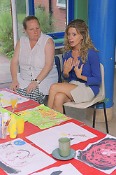 Young woman talking during counselling session at women's shelter,