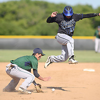 Laura Stoecker/lstoecker@dailyherald.com<br /> Bartlett's Matt Vitulli scoops up the ball to throw to first as St. Charles North's Frankie Farry leaps to avoid a collision on the way to third base in the second inning of the 4A regional game on Friday, May 24.
