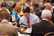 Wisconsin Governor and potential Republican presidential candidate Scott Walker bows his head in prayer during a GOP lunch event March 20, 2015 in Charleston, South Carolina.