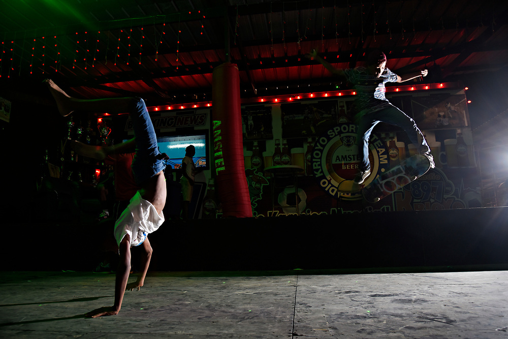 WILLEMSTAD, CURACAO - DECEMBER 12, 2014: Joshua Leatu, 9, does a handstand while Alex Johannes, 13, does a kick flip off the stage next to the Frank Curiel Ball Park. The boys have friends playing in the tournament there, but spent most of their time away from the stands, skateboarding and socializing. (photo by Melissa Lyttle)