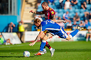 Ipswich Town forward James Norwood (10) and Gillingham FC defender Connor Ogilvie (6) during the EFL Sky Bet League 1 match between Gillingham and Ipswich Town at the MEMS Priestfield Stadium, Gillingham, England on 21 September 2019.