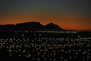 Sunset in Cape Town with Devils Peak and the Table Mountain Range. View from Gondon's Bay, South Africa.