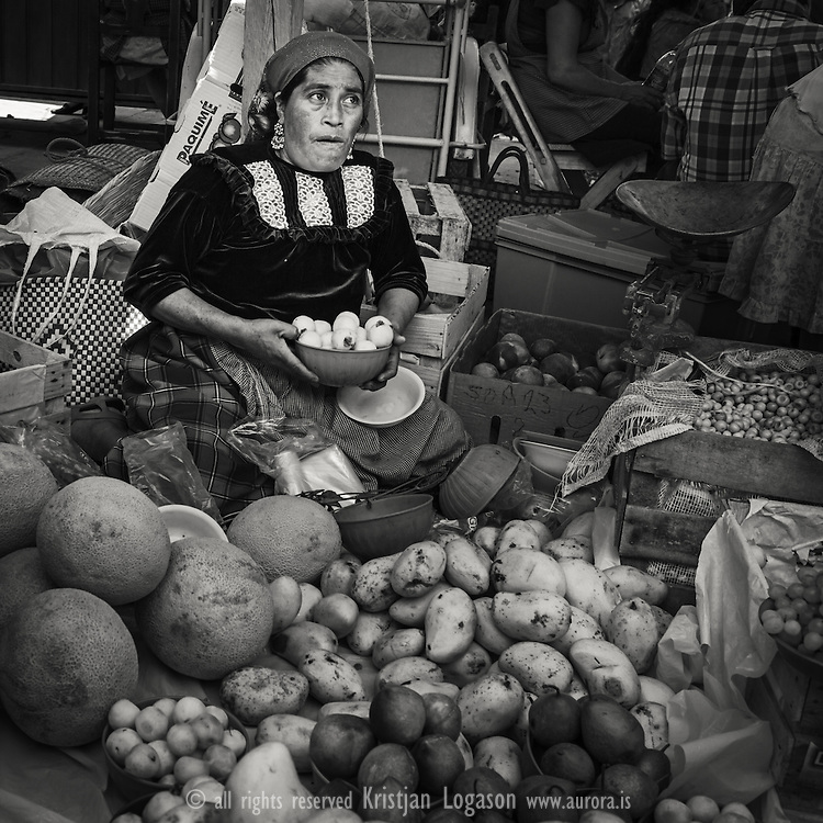 Woman selling fruits at the market in Tlacoloulu