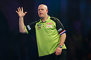 Michael van Gerwen, holds five fingers, during the World Darts Championships 2018 at Alexandra Palace, London, United Kingdom on 29 December 2018.