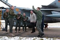 """30 NOV 2010, JAGEL/GERMANY:<br /> Karl-Theodor zu Guttenberg (2.v.R.), CSU, Bundesverteidigungsminister, und Oberst Karsten Stoye (R), Kommodore Aufklaerungsgeschwader 51 """"Immelmann"""", begruessen Piloten nach der Rueckkehr der in Afghanistan eingesetzten RECCE TORNADO Aufklaerungsjets, Aufklaerungsgeschwader 51 """"Immelmann"""", Fliegerhorst Jagel<br /> IMAGE: 20101130-01-023<br /> KEYWORDS: Bundeswehr, Armee, Luftwaffe"""