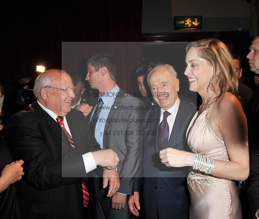 Left to right, MIKHAIL GORBACHEV, SHIMON PERES and SHARON STONEat a gala eveing to celebrate the 80th birthday of former Soviet leader Mikhail Gorbachev held at The Royal Albert Hall, London on 30th March 2011.