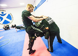 Kicking pads. Stef Noij, KMG Instructor from the Institute Krav Maga Netherlands, the IKMS G Level Programme seminar today at the Scottish Martial Arts Centre, Alloa.