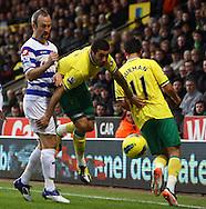 Picture by Paul Chesterton/Focus Images Ltd.  07904 640267.26/11/11.Bradley Johnson of Norwich bursts past QPR's Shaun Derry during the Barclays Premier League match at Carrow Road Stadium, Norwich.