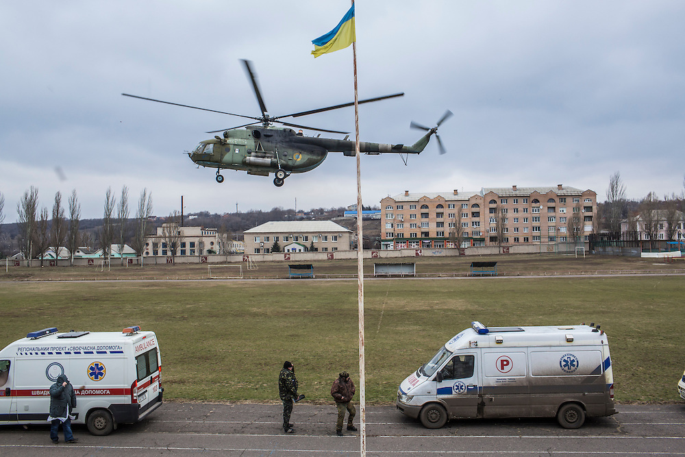 ARTEMIVSK, UKRAINE - FEBRUARY 8, 2015: A medevac helicopter lands on a sports field, where it will pick up wounded Ukrainian soldiers and take them to Dnipropetrovsk in Artemivsk, Ukraine. Fighting between pro-Russia rebels and Ukrainian forces has dealt steady casualties to Ukrainian fighters and civilians. CREDIT: Brendan Hoffman for The New York Times