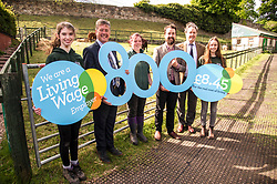 Pictured: Kirsty McGoff, Keith Brown, Maia Gordon, Josiah Lockhart, George Ellie and Zoe White<br /> <br /> Cabinet Secretary for Economy, Jobs &amp; Fair Work Keith Brown visited Gorgie City Farm today  to mark their accreditation as the 800th Living Wage employer in Scotland. Mr Brown met Josiah Lockhart, CEO and undertook a short tour of the farm, celebrating their accreditation and promoting the Living Wage more generally. The Scottish Government has set a target of reaching 1,000 Scottish-based Living Wage Accredited Employers by autumn 2017. While at the farm Mr Brown met Maia Gordon, Kirsty McGoff (17) and Zoe White (18), who have benefited from the living wage, and George Ellis, chair of the farm's board of directors<br /> Ger Harley | EEm 18 May 2017