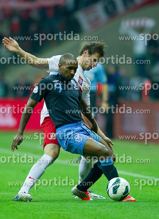 (L) England's Jermain Defoe fights for the ball with (R) Poland's Grzegorz Krychowiak (nr08) during the 2014 World Cup Qualifying Group H football match between Poland and England at National Stadium in Warsaw on October 17, 2012...Poland, Warsaw, October 17, 2012..Picture also available in RAW (NEF) or TIFF format on special request...For editorial use only. Any commercial or promotional use requires permission...Photo by © Adam Nurkiewicz / Mediasport