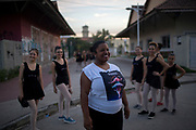 Daiana    the coordinator of Manguinhos community ballet poses outside the Biblioteca Parque in Manguinhos neighbourhood in Rio de Janeiro, Brazil, Monday, June 11, 2018.  The Manguinhos community ballet has been a reprieve from the violence and poverty that afflicts its namesake neighborhood for hundreds of girls who have benefitted from free dance classes since 2012. (Dado Galdieri for The New York Times)