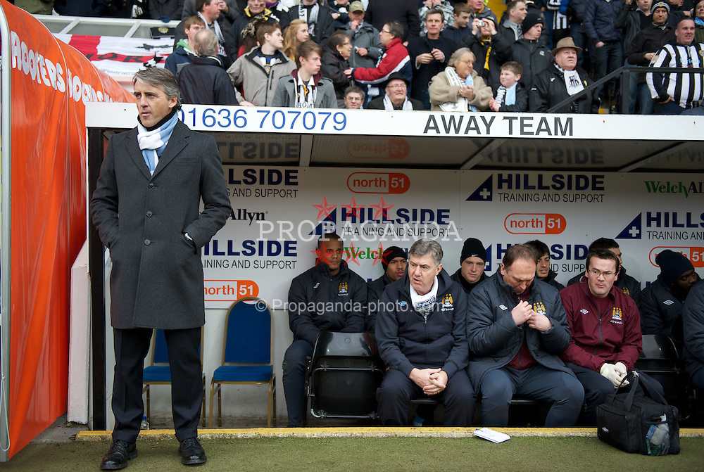 NOTTINGHAM, ENGLAND - Sunday, January 30, 2011: Manchester City's manager Roberto Mancini during the FA Cup 4th Round match against Notts County at Meadow Lane. (Photo by David Rawcliffe/Propaganda)