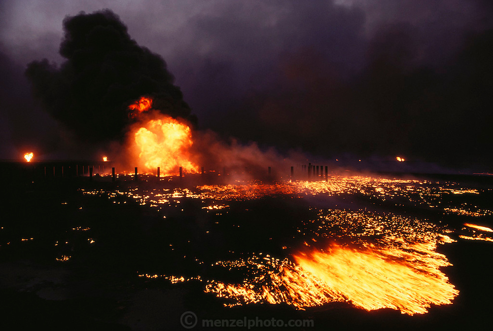 The burning Magwa oil fields near Ahmadi in Kuwait after the end of the Gulf War in May of 1991. More than 700 wells were set ablaze by retreating Iraqi troops creating the largest man-made environmental disaster in history.