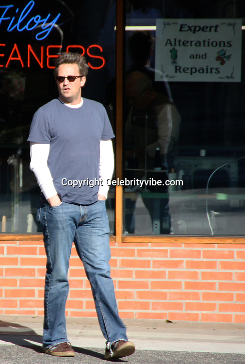 **EXCLUSIVE**.Matthew Perry of Friends TV Show had lunch at La Scala Restaurant with a mystery woman, she was making him smile as they come out of the parking lot where she is driving..Beverly Hills, CA, USA..Friday, January 30, 2009..Photo By Celebrityvibe.com..To license this image please call (212) 410 5354; or Email: celebrityvibe@gmail.com ;.website: www.celebrityvibe.com.