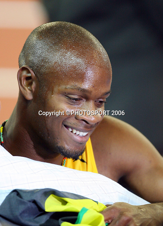 Portrait of Jamaican athlete Asafa Powell (JAM) after winning the Men's 100M sprint on Day 5 of the XVIII Commonwealth Games at the MCG, Melbourne, Australia on Monday 20 March, 2006. Photo: Hannah Johnston/PHOTOSPORT<br />
