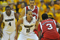Jan 23, 2010; Columbia, MO, USA; Nebraska Cornhuskers guard Brandon Richardson (3) looks to pass as Missouri Tigers guard Michael Dixon Jr. (10) plays defense in the second half at Mizzou Arena in Columbia, MO. Missouri won 70-53. Mandatory Credit: Denny Medley-US PRESSWIRE