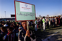 A disable athlete holds the SOA's banner during the  opening ceremony at Ghazi Stadium, Kabul...On 23-25 August 2005, Special Olympics Afghanistan held its first national Games at Olympic Stadium in Kabul. More than 300 athletes, including 80 female athletes, experienced a taste of happiness and achievement for the first time in their lives. They competed in athletics, bocce and football (soccer). Because of cultural restrictions, males and females competed at separate venues.