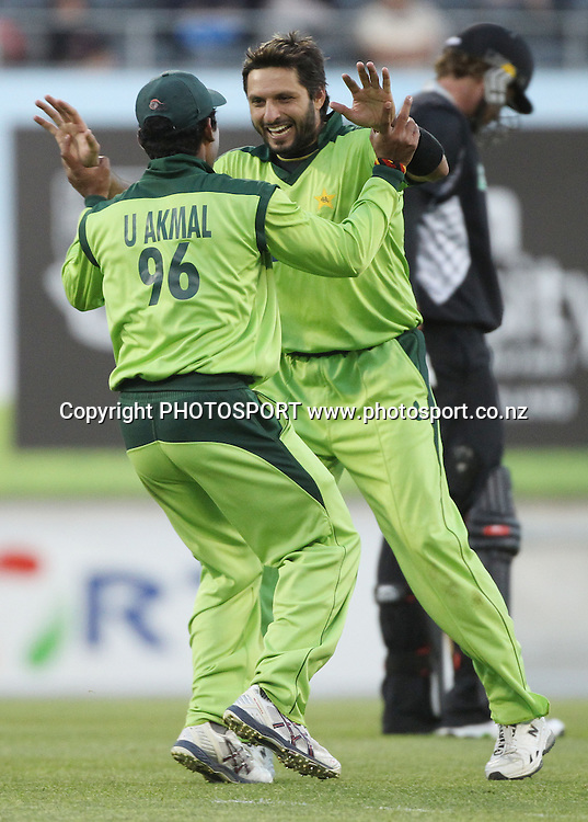 Umar Akmal celebrates with captain Shahid Afridi after a direct hit to dismiss McCullum during the 3rd ODI, Black Caps v Pakistan, One Day International Cricket. AMI Stadium, Christchurch, New Zealand. Saturday 29  January 2011. Photo: Andrew Cornaga/photosport.co.nz