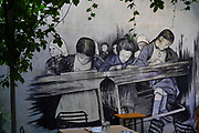 Athens, Greece, Graffiti of school girls in a vintage classroom on a wall