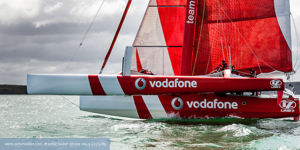 Vodafone trimaran under sail off Rangitoto Island. Auckland.