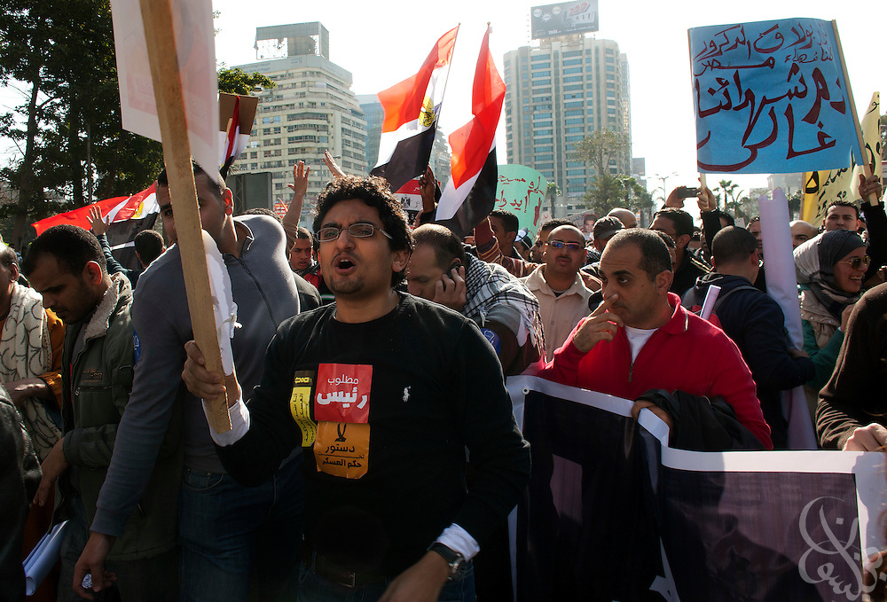 Egyptian revolutionary activist Wael Ghonim (c) marches in a January 25, 2012 protest in Cairo, Egypt. Activists such as Ghonim who began the revolution a year ago still believe the goals of the revolution are unfinished.