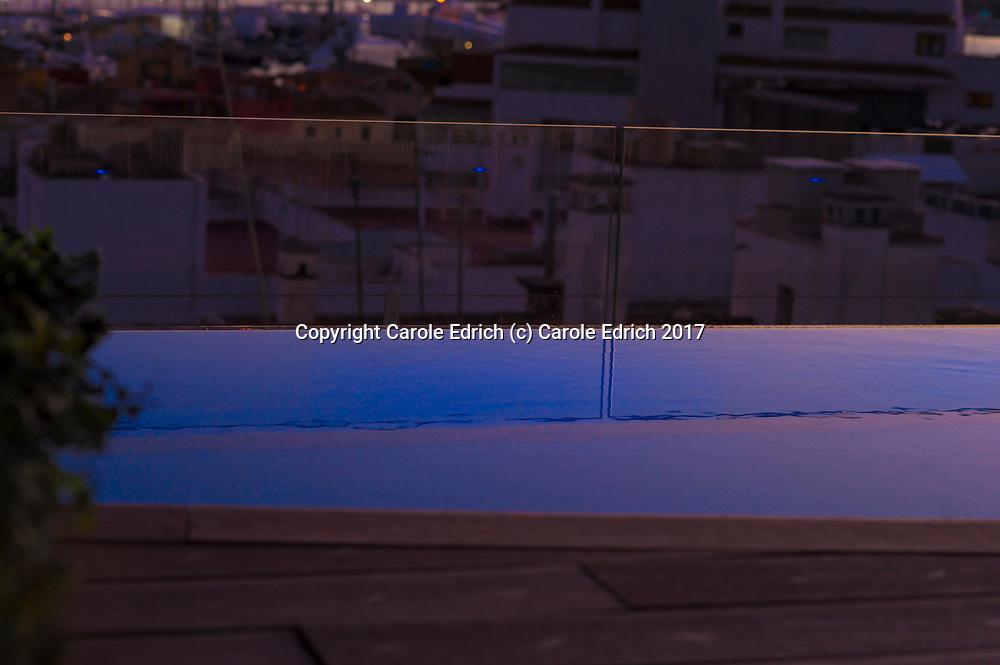 Blue-lit pool at sunset