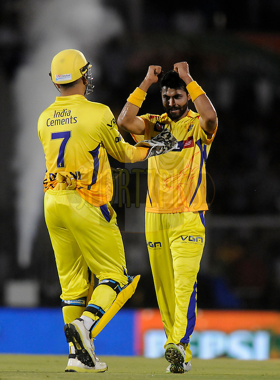Ravindra Jadeja of The Chennai Superkings celebrates the wicket of Michael Hussey of the Mumbai Indians during the eliminator match of the Pepsi Indian Premier League Season 2014 between the Chennai Superkings and the Mumbai Indians held at the Brabourne Stadium, Mumbai, India on the 28th May  2014<br /> <br /> Photo by Pal PIllai / IPL / SPORTZPICS<br /> <br /> <br /> <br /> Image use subject to terms and conditions which can be found here:  http://sportzpics.photoshelter.com/gallery/Pepsi-IPL-Image-terms-and-conditions/G00004VW1IVJ.gB0/C0000TScjhBM6ikg