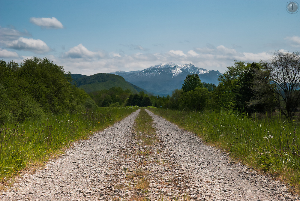 A low-angle shot of a road leading up to Asahi-dake, one of the highest peaks in Daisetsuzan National Park in Hokkaido, Japan.