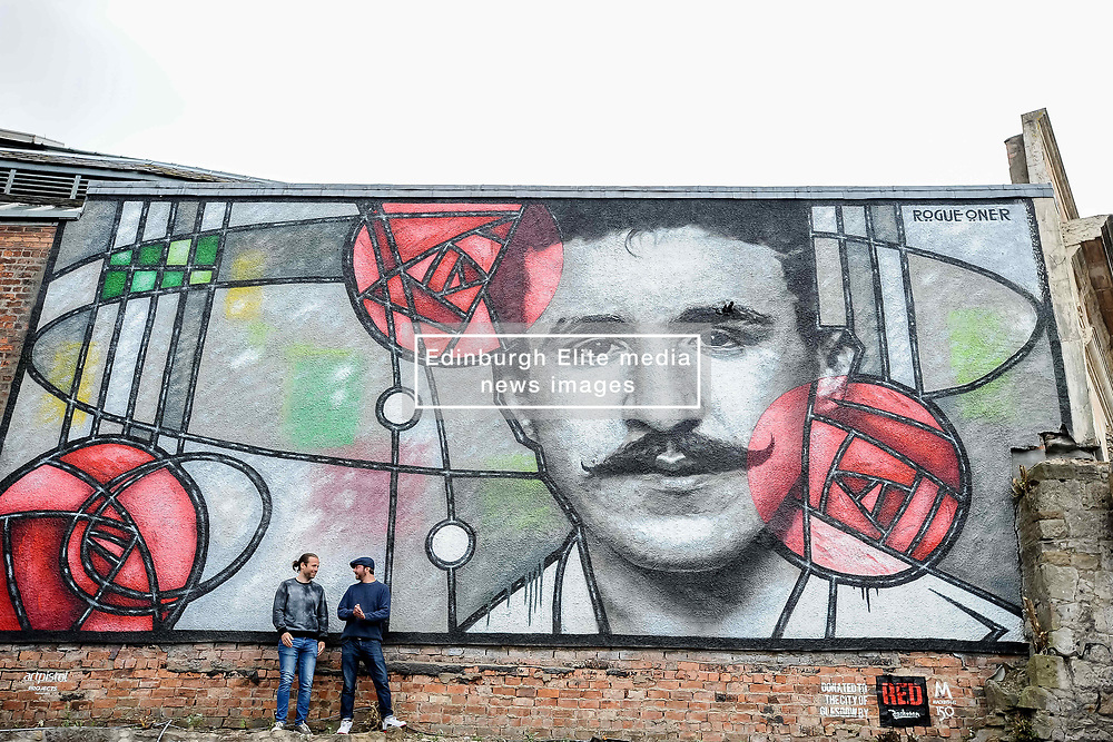 Pictured: Art Pistols Projects founder Ali Smith (left) and artist Bob McNamara aka Rogue One with the mural.<br /> <br /> A giant street mural, inspired by the work of Charles Rennie Mackintosh, by Art Pistols Projects and artist Rogue-One has been unveiled in Glasgow City Centre. <br /> © Dave Johnston / EEm