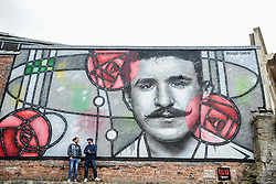 Pictured: Art Pistols Projects founder Ali Smith (left) and artist Bob McNamara aka Rogue One with the mural.<br /> <br /> A giant street mural, inspired by the work of Charles Rennie Mackintosh, by Art Pistols Projects and artist Rogue-One has been unveiled in Glasgow City Centre. <br /> &copy; Dave Johnston / EEm