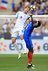 England's Eric Dier (left) and France's Paul Pogba battle for the ball during the International Friendly at the Stade de France, Paris.