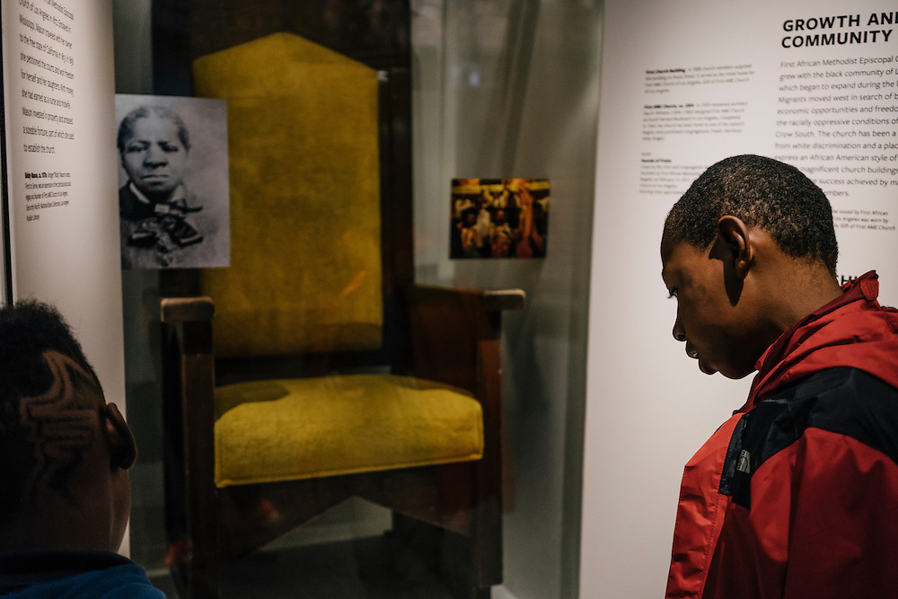 Sixth-graders from Knowledge Is Power Program (KIPP) DC, including Omari Sterling, 11, look at exhibits inside the Smithsonian National Musuem of African American History and Culture during their visit on Oct 21, 2016. The students spent an hour touring the new Washington, D.C. museum, which is only available to see with reserved tickets during the first year.