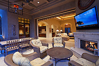Seating furniture near fireplace with television in room of luxury villa