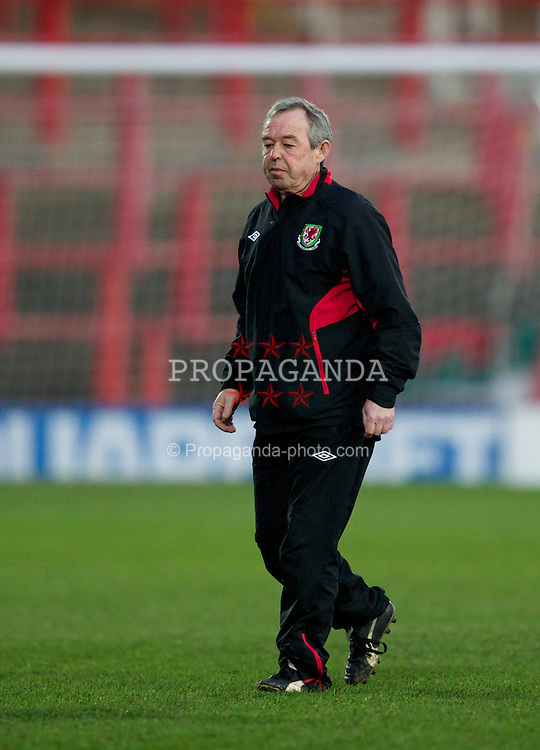 WREXHAM, WALES - Wednesday, February 29, 2012: Wales' manager Brian Flynn walks off the pitch after his side's 4-0 win over Andorra in the UEFA Under-21 Championship Qualifying Group 3 match at the Racecourse Ground. (Pic by Vegard Grott/Propaganda)