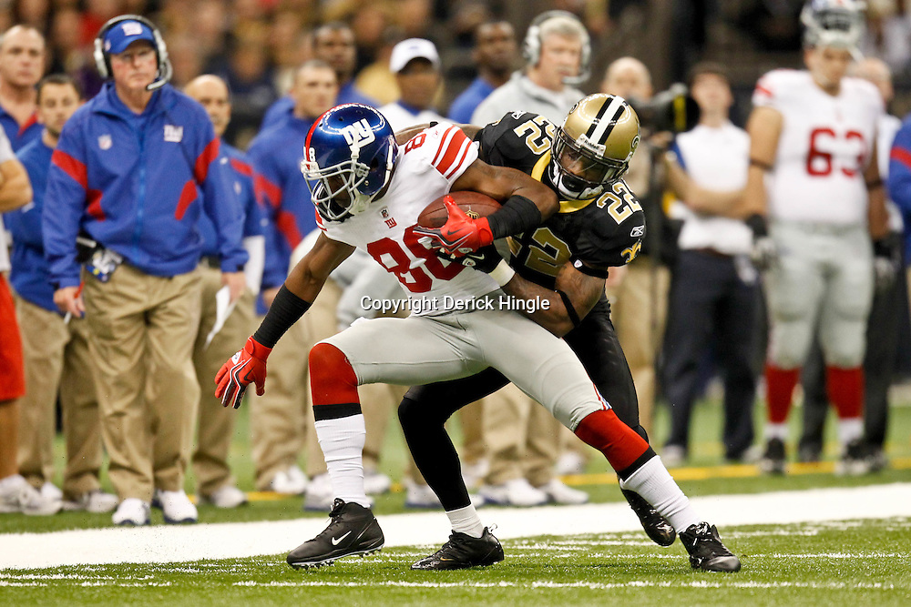 November 28, 2011; New Orleans, LA, USA; New York Giants wide receiver Hakeem Nicks (88) is tackled by New Orleans Saints cornerback Tracy Porter (22) during the second quarter of a game at the Mercedes-Benz Superdome. Mandatory Credit: Derick E. Hingle-US PRESSWIRE