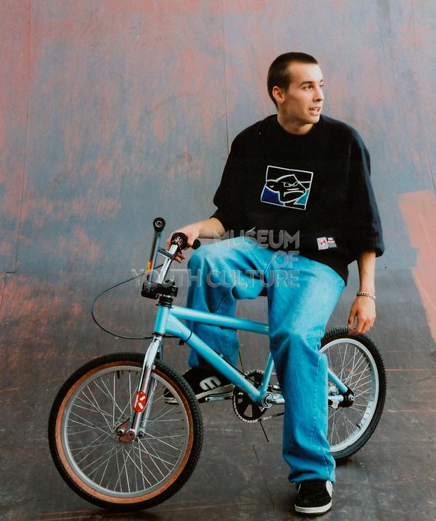 Teenager sitting on his BMX bike