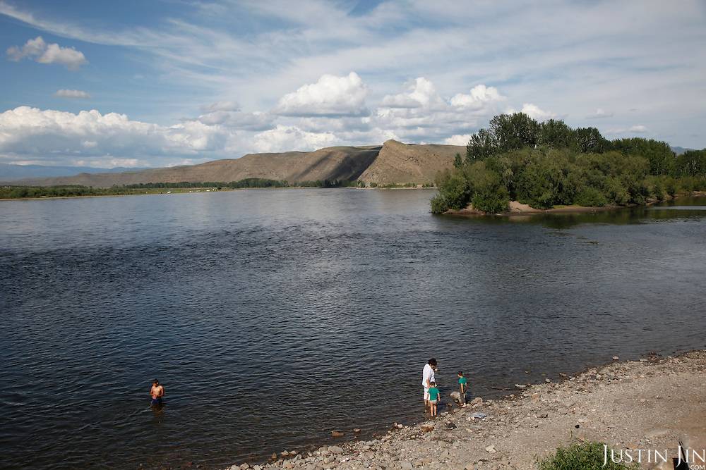 A family swims in the Yenesei River in Tuva Republic, Russia