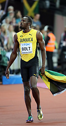 August 5, 2017 - London, England - Superstar track phenom, the crowd  favorite, legendary Jamaican sprinter, USAIN BOLT, 30, greets fans, sees family and answers TV pressing concerns, on his victory lap after his last solo track race, finishing n 9.95, for the Bronze Medal in the 100 meter men's race, at the IAAF 2017 World Championship London. The biggest sporting event of  2017. (Credit Image: ? Scott Mc Kiernan via ZUMA Wire)