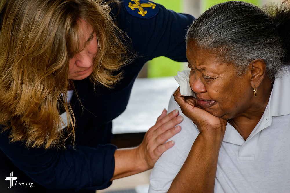 Deaconess Kim Schave comforts a founding LCMS congregation member outside her home on Tuesday, Sept. 26, 2017, in Houston. Her home was severely damaged by flood waters from Hurricane Harvey. LCMS Communications/Erik M. Lunsford