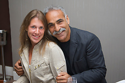 LIVERPOOL, ENGLAND - Tuesday, June 10, 2008: Legend Mansour Bahrami with Olga Savchuk during a night out at 60 Hope Street on the opening day of the Tradition-ICAP Liverpool International Tennis Tournament. (Photo by David Rawcliffe/Propaganda)