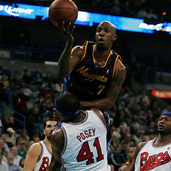 28 January 2009: Denver Nuggets guard Chauncey Billups (7) draws a foul on New Orleans Hornets forward James Posey (41) during a 94-81 win by the New Orleans Hornets over the Denver Nuggets at the New Orleans Arena in New Orleans, LA. The Hornets wore special throwback uniforms of the former ABA franchise the New Orleans Buccaneers for the game as they honored the Bucs franchise as a part of the NBA's Hardwood Classics series. .