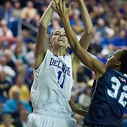01/12/12 Newark DE: Delaware Junior Forward #11 Elena Delle Donne and the U.S. Basketball Writers Association Women's National Player of the Week attempts a shot range shot during a Colonial Athletic Association Conference Basketball Game against The University of North Carolina Wilmington Seahawks Thursday, Jan. 12, 2012 at the Bob Carpenter Center in Newark Delaware.