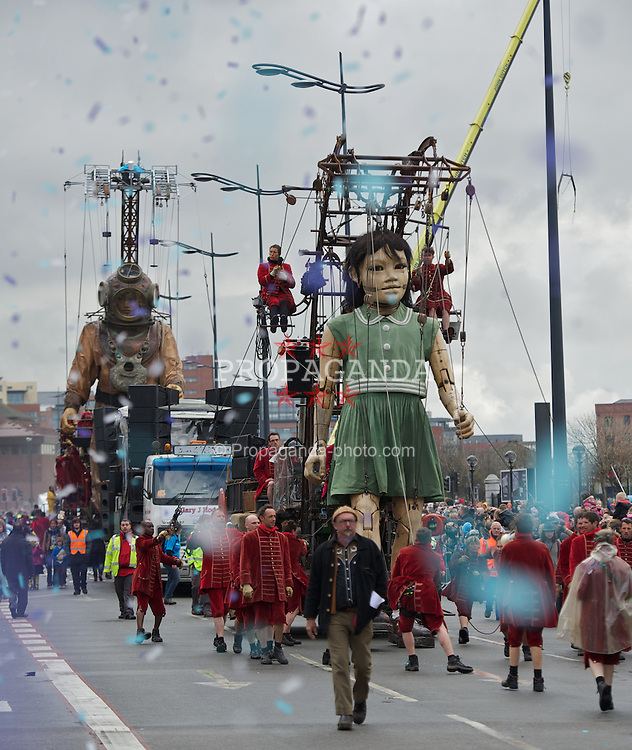 LIVERPOOL, ENGLAND - Sunday, April 22, 2012: The Little Girl Giant and her Uncle the Diver, walk through Liverpool as part of Sea Odyssey - a Giant Spectacular. Two marionettes controlled by lilliputians, a driver and a girl, his niece, roam through the city's streets looking for each other. The free event, organised by French company Royal de Luxe is one of a series of events marking the 100th anniversary of the sinking of the Titanic. (Pic by David Rawcliffe/Propaganda)