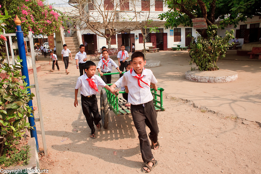 Mar. 10, 2009 -- VIENTIANE, LAOS: Boys play in the schoolyard after classes at an elementary school in Vientiane, Laos.  Photo by Jack Kurtz / ZUMA Press