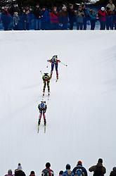 23.01.2011, Südtirol Arena, Antholz, ITA, IBU Biathlon Worldcup, Antholz, Mass Start Women, im Bild Zuschauer beobachten Svetlana Sleptsova (RUS),  Marie Laure Brunet (FRA), Magdalena Neuner (GER) // Svetlana Sleptsova (RUS),  Marie Laure Brunet (FRA), Magdalena Neuner (GER) and spectors during IBU Biathlon World Cup in Antholz, Italy, EXPA Pictures © 2011, PhotoCredit: EXPA/ J. Feichter